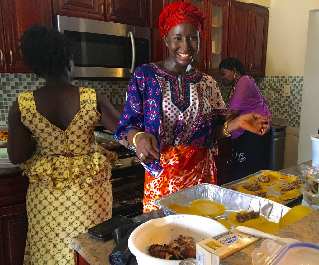 friendly Gambian women, making an epic feast from scratch
